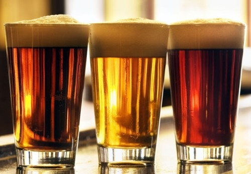 Three Pints of Beer on a Bar